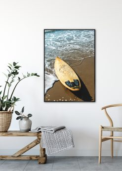 Yellow Surfboard on a Beach